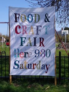 Food and Craft Fair Banner raised in Great Wilbraham