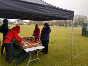 Customers and stall holders braving the elements